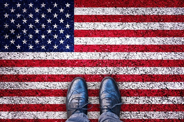Legs on asphalt road with USA flag, american election concept
